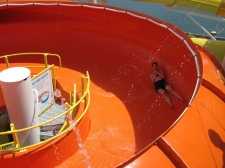 The Champagne Bowl is a SpaceBowl waterslide designed to fit on the deck of the ship