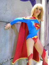 Supergirl animatronic holding up a falling wall in Justice League: Alien Invasion 3D