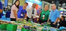 Rick Hunter of ProSlide Technology (pictured center) points out new attraction options.